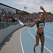 LoLo Jones acknowledges the crowd after winning the 100 meter hurdles at the Drake Relays last April in DesMoines, Iowa.  Jones won the United States Olympic Trials in Eugene Oregon two months later, and is one of the favorites for a gold medal at this year's Olympic Games in Beijing, China.