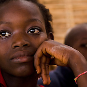 Girl in classroom at the Tangory Transgambienne 2 primary school in the town of Bignona, Senegal on Wednesday June 13, 2007.
