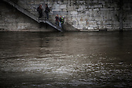Swollen river Seine raises Paris in high alert as water surge to record levels.  Seen from Saint Louis island, Parisians wander on the flooded banks of the Saint Louis Island near the Notre Dame cathedral. 04 June 2016.