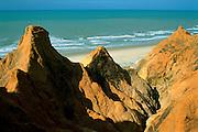 Brazil, Ceara, Atlantic coast, eroded sandy cliffs at Morro Branco Beach.