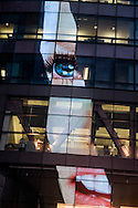 New York , Times square , reuters building. The EYE . mirror game on a buiding. / la tour Reuters a Times square. L' oeil. refletsur un tour miroir