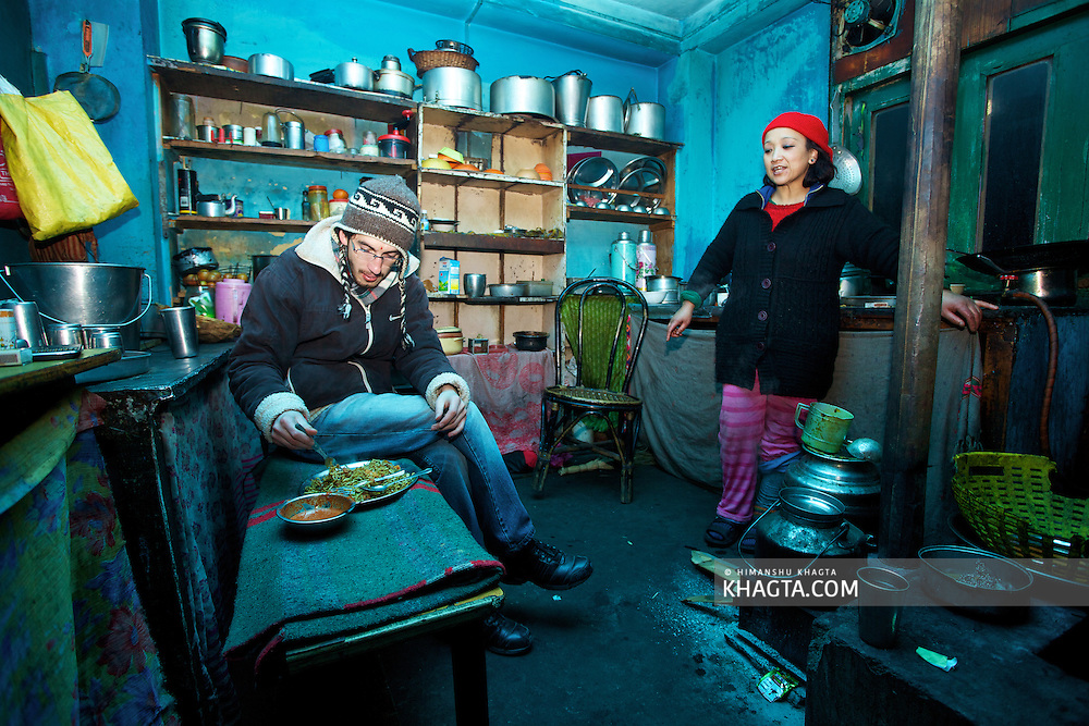 A traveller having his dinner at a Dhaba in Sangla, Kinnaur. ..Sangla Valley was opened for tourists in the year 1992 and since then is a famous tourist place for Indian as well as foreign tourists.