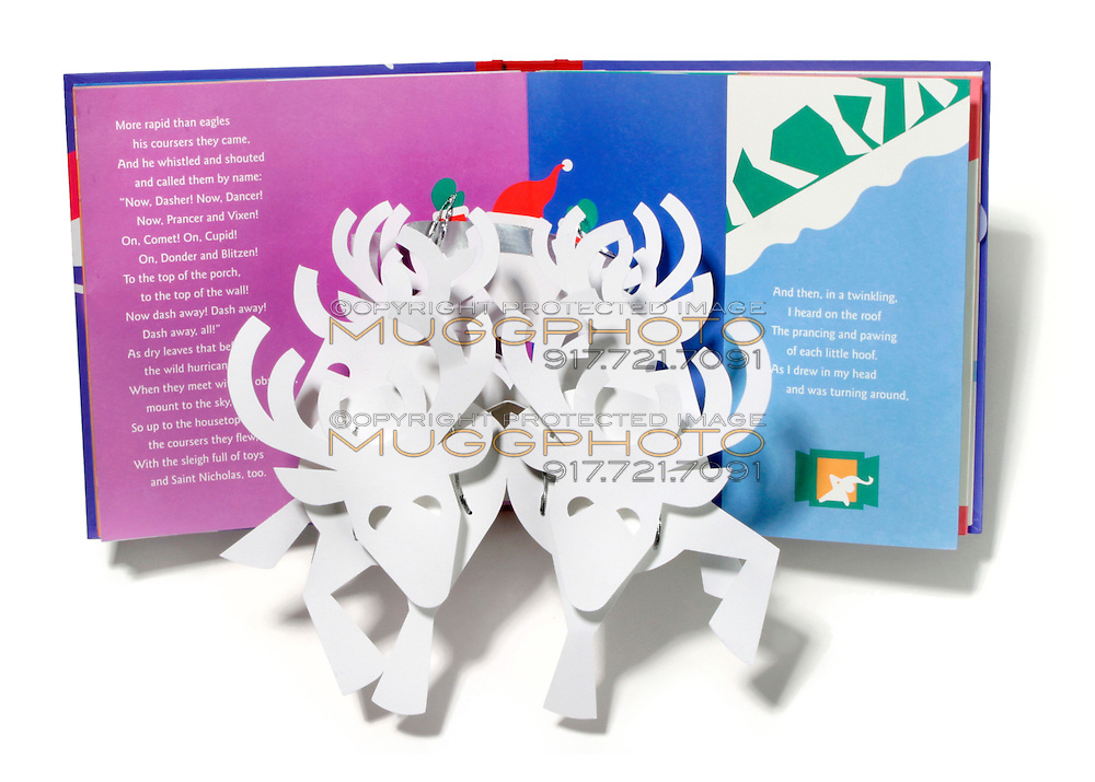 A Christmas themed pop-up book showing reindeer photographed on a white background.