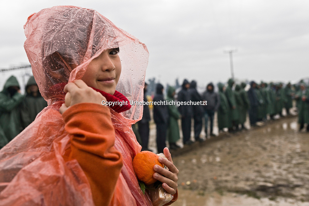 Greece, Idomeni, Refugees on their way to Europe,   Children in Idomeni<br /> <br /> Idomeni, is the eye of a needle for getting to nothern Europe. <br /> Girl from Afghanistan, got a sandwich, an orange and a boiled egg after waiting outdoor for at least 45 min in the rain, in Idomeni.<br /> <br /> <br /> Red Cross Team from Hungry during their shift at the Emergency Room, Hospital.<br /> <br /> Nadeloehr nach Nordeuropa Idomeni, der Grenzuebergang ist seit Wochen gesperrt,. <br /> <br /> <br /> <br /> <br /> <br /> keine Veroeffentlichung unter 50 Euro*** Bitte auf moegliche weitere Vermerke achten***Maximale Online-Nutzungsdauer: 12 Monate !! <br /> <br /> for international use:<br /> Murat Tueremis<br /> C O M M E R Z  B A N K   A G , C o l o g n e ,  G e r m a n y<br /> IBAN: DE 04 370 800 40 033 99 679 00<br /> SWIFT-BIC: COBADEFFXXX