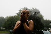 Melissa stands out in the rain in Eastlake, Ohio on July 2, 2006.