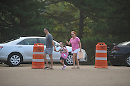 Jon Myrick (left) and Nancy Nations (right) walk their daughter Lucy Myrick to school on the first day of school at Bramlett Elementary in Oxford, Miss. on Thursday, August 4, 2011.
