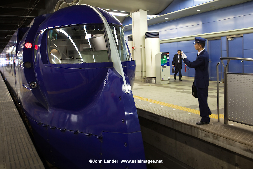 Rap:t limited express trains take 30 minutes and cost 1390 yen all reserved seats from Kansai Airport to Namba Station - in this unusual train that was designed to be both futuristic looking and retro at the same time.