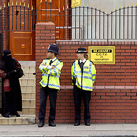 Police guarding Finsbury Park mosque due to fears of a backlash against the Muslim community. The city was on heightened alert following the terrorist attacks on underground trains and on a bus which killed over fifty people the previous day.