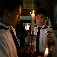 Alter boys prepare for dawn mass, Arayat, Pampanga, Philippines