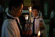 Alter boys prepare for dawn mass, Arayat, Pampanga, Philippines