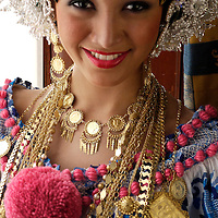 Model released photograph of a Panamanian model in her twenties dressed up with the traditional Pollera.