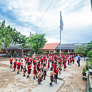 CAPTION: Pupils at SDN 1 Primary School do their morning exercises. This is one of the four pilot schools that has participated in the University of Lampung's education project, which aims to improve the capacity of students and teachers to adapt to climate change. LOCATION: SDN 1 School, Langkapura, Bandar Lampung, Indonesia. INDIVIDUAL(S) PHOTOGRAPHED: N/A.