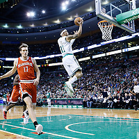 21 December 2012: Boston Celtics shooting guard Courtney Lee (11) goes for the layup on a fast break past Milwaukee Bucks small forward Mike Dunleavy (17) during the Milwaukee Bucks 99-94 overtime victory over the Boston Celtics at the TD Garden, Boston, Massachusetts, USA.