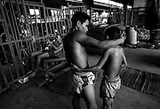 Different generations of fighters train at the Muay Thai Boxing Club under the freeway at Khlong Toei, Bangkok Thailand March 2003.©David Dare Parker/AsiaWorks Photography