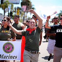"Marine Jaime Rincon,M marches down University Avenue, with other military personel, during the San Diego Gay Pride Parade  in San Diego, California .  Hundreds of active duty military personel -gay and straight, participated for the first time in the march as the governments official ""Don't ask Don't Tell"" policy slowly comes to an end."