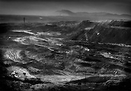 Open pit coal mine on the back side of Buddhist temple mountain, Lao Shi Dan, Inner Mongolia, China.