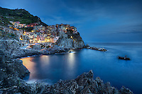 Manarola, built on a high rock 70 metres above sea level, is one of the most charming and romantic of the Cinque Terre villages in Italy. The tiny harbour features a boat ramp, picturesque multicoloured houses facing the sea and a tiny piazza with seafood restaurants. Along the main road the boats are pulled onto dry land every time the sea is rough. And although there is no real beach there, it has some of the best deep-water swimming around.