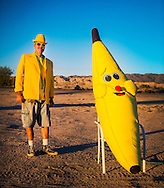 """Fred Garbutt, proprietor and owner of the International Banana Museum on Highway 111 near North Shore. Garbutt opened the business in the last year after purchasing a banana-themed collection. Garbutt acknowledges the wacky nature of his business, but said """"as long as you come give me a dollar I don't give a fuck."""""""