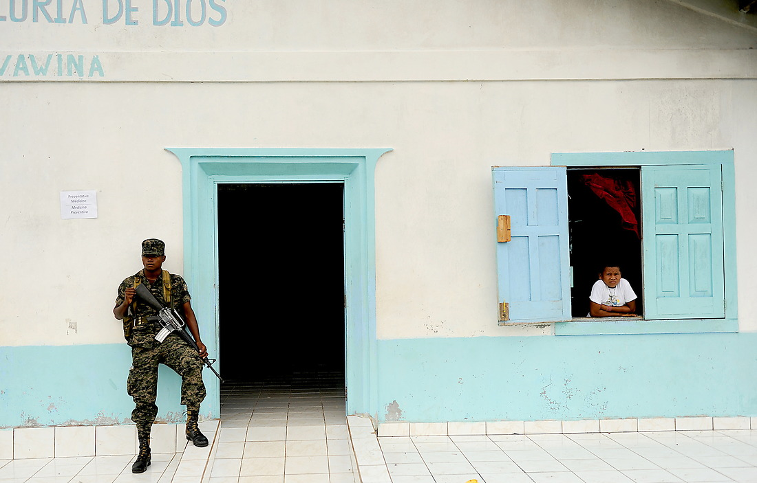 Honduran military members provide security while the U.S. Military medical team sees patients in Wawina, Honduras. — © /