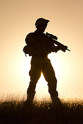 Model-released men in tactical desert environment.  Visible gear may include MSA armor, CeJay Engineering beacons, Ownnight night vision systems, ESS eyepro.  Photograph is protected by registered US copyright.  Reproduction without written authorization is prohibited.  Contact Military Stock Photography for information and reproduction information.