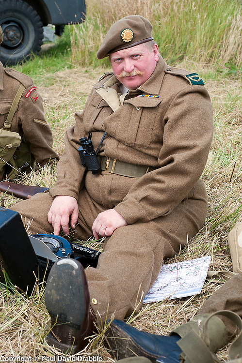 A reenactor portrays a uniformed war correspondent with portable Typewriter at the Spam Wartime Weekend Heckmondwike<br /> 10th July 2011<br /> Images &copy; Paul David Drabble
