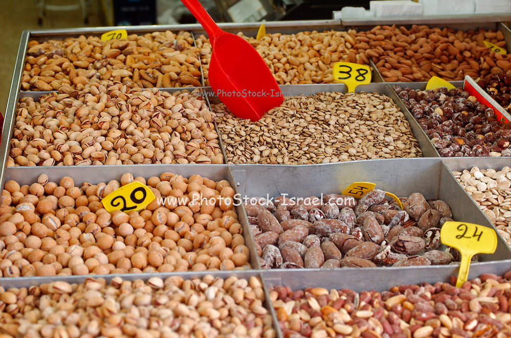 Israel, Tel Aviv, Lewinski market, nuts and seeds (such as pumpkin, watermelon or sunflower) that are cracked open with the teeth and eaten as snack food