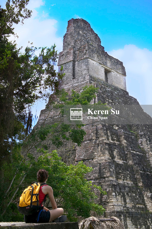 Western traveler with Temple I, Tikal Ruins, Guatemala