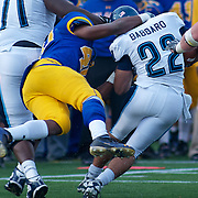 Delaware LB (#40) Andrew Harrison takes down RB (#22) Angelo Babbaro in the fourth quarter. No.1 Delaware loses to No.15 Villanova 28-21 on a brisk Saturday afternoon at Delaware stadium in Newark Delaware...Delaware will have to wait until Sunday 11/21/10 to receive a NCAA Tournament playoff berth.
