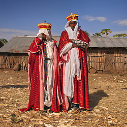 Addisu, 23 and his new bride Destaye, 11, are married in a traditional Ethiopian Orthodox wedding in the rural areas outside the city of Gondar, Ethiopia. Community members said that because of his standing as a priest, Addisu's bride had to be a virgin. This was the reason Destaye was given to him at such a young age.