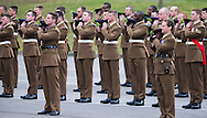 Soldiers from the 1st Battalion the Irish Gurads remove their caps in salute to the Duke and Duchess of Cambridge who attended their annual St Patrick's Day Parade at Mons Barracks, Aldershot, Hampshire.<br /> Picture date Monday 17th March, 2014.<br /> Picture by Christopher Ison. Contact +447544 044177 chrisison@mac.com
