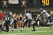 Mississippi wide receiver Ja-Mes Logan (85) is chased by Vanderbilt defensive back Steven Clarke (12) as Mississippi's Laquon Treadwell (1) blocks in Nashville, Tenn. on Thursday, August 29, 2013.