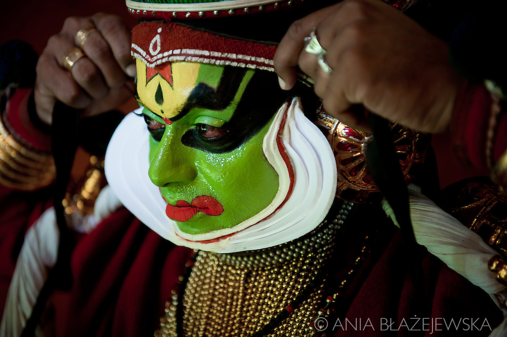 Kathakali  (the word &quot;kathakali&quot; literally means &quot;Story-Play&quot;) is one of the oldest theatre forms in the world, characteristic for  the south Indian state of Kerala. It has a long tradition dating back to the 17th century.&nbsp; <br /> <br /> It is a group presentation, in which dancers take various roles in performances traditionally based on religious and nature themes from Hindu mythology, especially the two epics, the Ramayana and the Mahabharata. <br /> <br /> Kathakali is widely recognizable for its distinctive costumes and sophisticated make up. Depending on a character the make up can be predominantly green (fhe faces of noble male characters, such as virtuous kings, the divine hero Rama etc.), green slashed with red marks on the cheeks (characters of high birth who have an evil streak, such as the demon king Ravana) or predominantly red (extremely angry characters). All the make up's  are made from natural materials: the white one is made from rice flour, the red from Vermillion and the black is made from sook. <br /> <br /> The actors rely very heavily on hand gesture to convey the story.&nbsp;These hand gestures, known as mudra, are common through out much of classical Indian dance. The body movements and footwork are very rigourous. To attain such a high level of of flexibility and muscle control required for this art, a Kathakali dancer needs years of a strenuous training special body massages.<br /> <br /> Although a traditional Kathakali performance is a major social event, which usually starts at dusk and lasts for the whole night culminating at the dawn hour, when Good finally conquers Evil, today sometimes it is modified for smaller urban audiences.