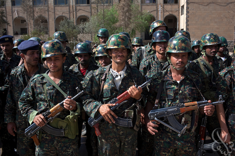 Armed soldiers of the Yemen Central Security Forces (CSF) stand in formation during a troop review April 14, 2010 on the parade grounds at the CSF headquarters in the Yemeni capital, Sana'a. Yemen faces a number of security problems including the Houthi rebellion in the north, separatists in the south and Al Qaeda in the Arabian Peninsula, but is taking steps to rapidly train and deploy a variety of security forces with the help of the USA, the UK, and other governments.