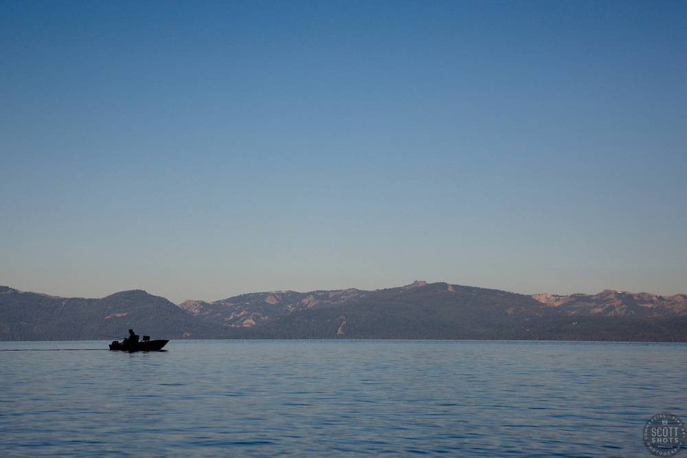 """Fishing Boat on Lake Tahoe"" - This silhouetted fishing boat was photographed near Sand Harbor, Lake Tahoe."