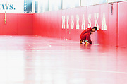 Nebraska wrestler Eric Montoya leans his head on the wall of the wrestling room before the Husker's duel against Iowa at the Bob Devaney Sports Center in Lincoln, Neb., on Jan. 24, 2016. Iowa defeated Nebraska.