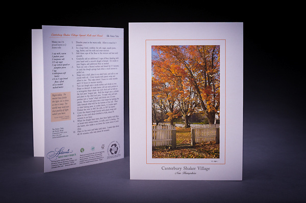 The majestic sugar maples and the white picket fence at the entrance to the Meetinghouse at Canterbury Shaker Village.  The card features the famous Canterbury Shaker Village Squash Rolls recipe.  Also available as a Limited Edition Fine Art Print. <br />