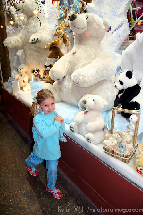 Christmas Bears in window bring smiles to little girl.