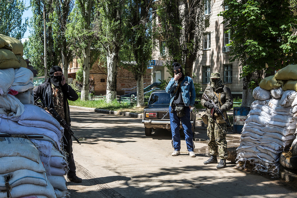 SLOVYANSK, UKRAINE - MAY 6:  Pro-Russian activists guard a barricade on May 6, 2014 in Slovyansk, Ukraine. Tensions in Eastern Ukraine are high after pro-Russian activists seized control of at least ten cities and ahead of the Victory Day holiday and a planned referendum on greater autonomy for the region. (Photo by Brendan Hoffman/Getty Images) *** Local Caption ***