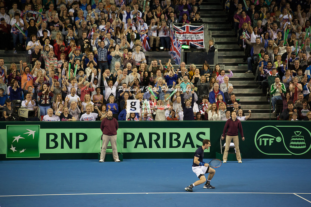 Andy Murray cry out in celebration as the crowd rise behind him