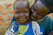 A mother and child in Avumadrici village, southern Sudan. The mother participates in a training center supported by Catholic Relief Services.