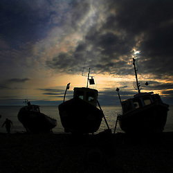 Pic By Paul Grover Pic Shows a fishing boat being pulled up on to the shore in the village of Beer on the South Devon coast Pic Paul Grover