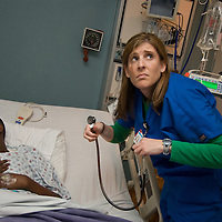 Nurse monitors the health of a patient in a pediatric cancer ward.