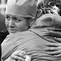 (Boston, MA - 1/21/15) Brigham & Women's Hospital workers embrace during a brief memorial for slain Dr. Michael Davidson outside the hospital, Wednesday, January 21, 2015. Staff photo by Angela Rowlings.