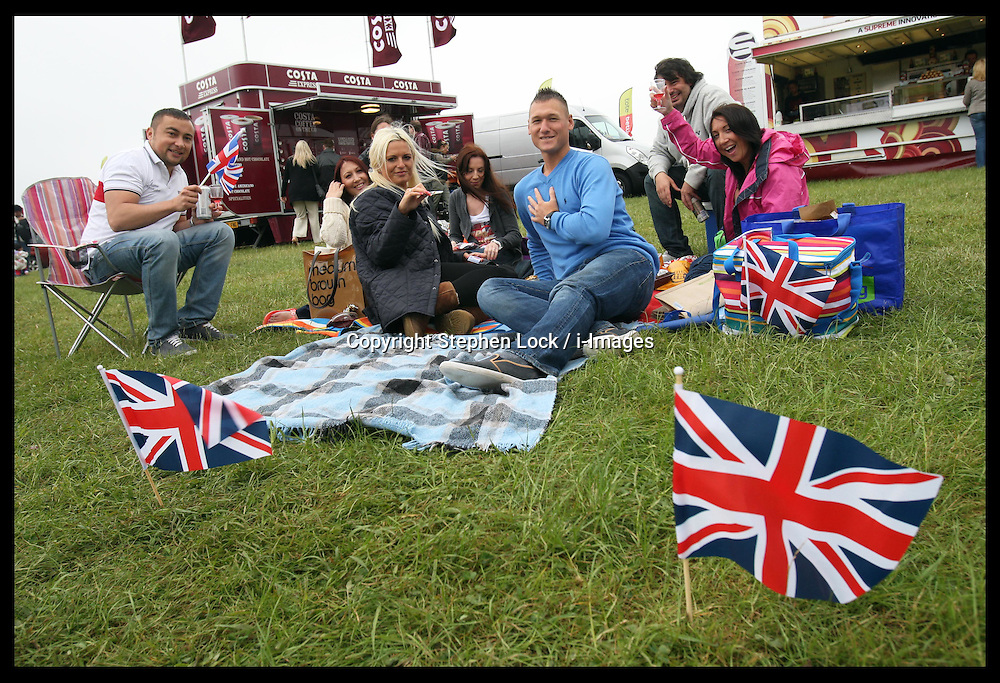 Racegoers  at  the Epsom Derby, Saturday, 2nd June 2012.  Photo by: Stephen Lock / i-Images