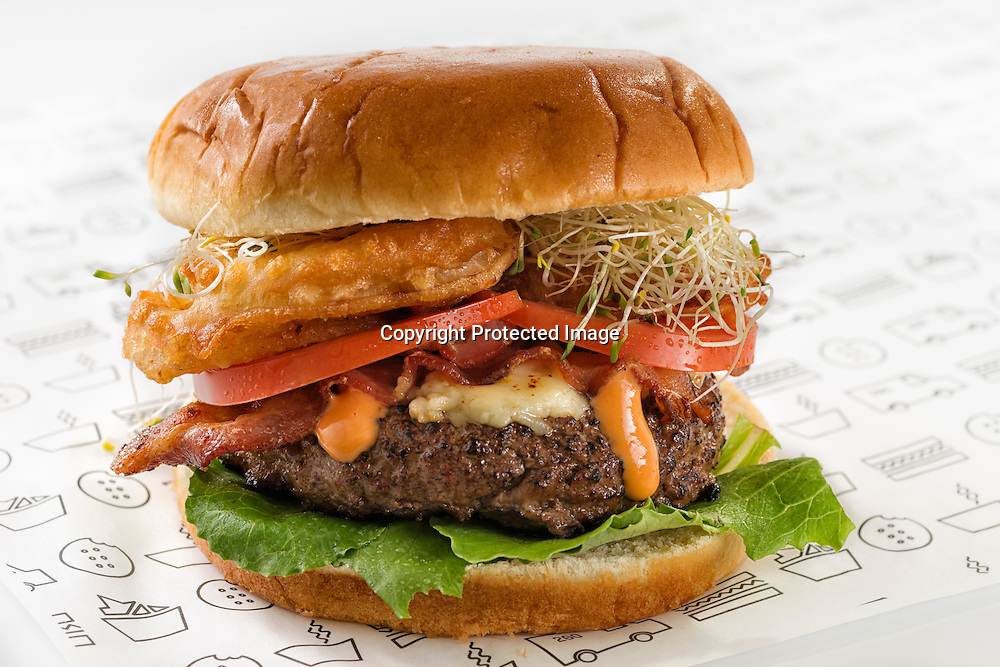 """Gourmet bacon burger with soy sprouts,tomato,onion rings,cheese,lettuce and """"Chipotle dressing"""""""