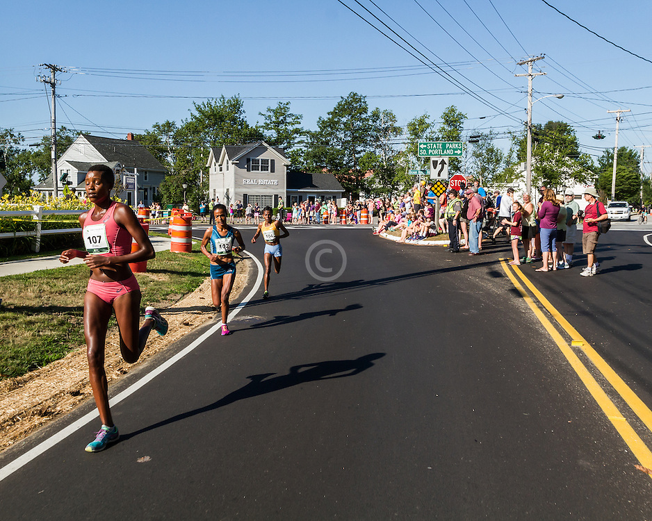 Diane Nukuri, Burundi, leads womens race near midpoint and turn from Route 77 onto Shore Road