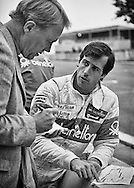 American F1 rookie race driver Danny Sullivan, driving for the Benetton Team Tyrrell&ndash;Ford team at the 1983 Detroit Grand Prix, discusses his approach to the tight city course with American racing legend Dan Gurney. <br /> <br /> Sullivan would score his best result of that season with a 5th place in the Monaco Grand Prix, and then leave Formula One to join Penske Racing, where he would put the &ldquo;Spin and Win&rdquo; pass on Mario Andretti to capture the 1985 Indianapolis 500 and later win the 1988 CART Championship. <br /> <br /> Gurney was the only American to win a Grand Prix with a car of his own construction at the 1967 Belgian Grand Prix. He also gained additional fame as the head of All-American Racers competing in Indianapolis and across the World racing circuits. <br /> <br /> Sullivan energized American open-wheel racing when he teamed with energy drink company Red Bull to organize and manage the American Red Bull Driver Search program, helping John Edwards (2007) and Scott Speed (2005) advance. Speed drove for Toro Rosso in Formula One during the 2006-7 seasons.