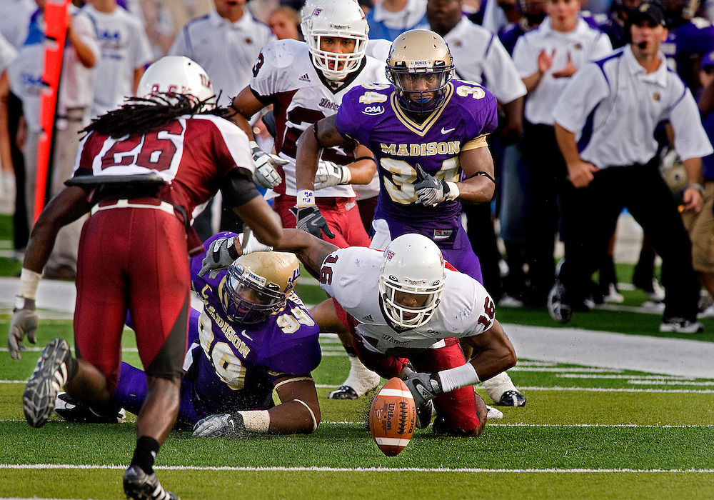 09/13/08-(Harrisonburg).JMU defensive end Hassan Abdul-Wahid and UMass defensive back Sean Smalls battle for a fumble in fourth quarter action at Bridgeforth Stadium in Harrisonburg Saturday. JMU held on to beat UMass 52-38..(Pete Marovich/Daily News-Record)