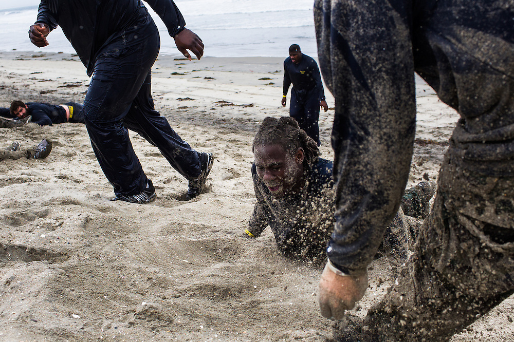 The University of Michigan Wolverines football team did a training session with the Navy SEALS in San Diego.