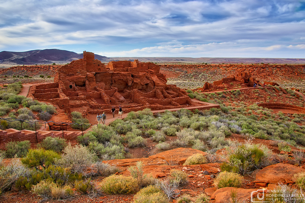 The Wupatki Ruins sit at the edge of the painted desert near Flagstaff, AZ. Scattered thru out the area are many remains of pueblos that were constructed out the the deep red flat rocks that are plentuful in Arizona.